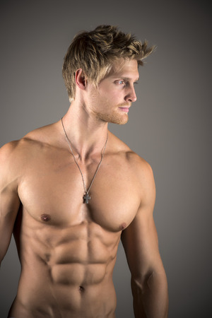 Blond athletic man with well developed abs and pecs Stock Photo