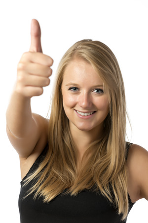 Young blond girl in black top with thumb up photo