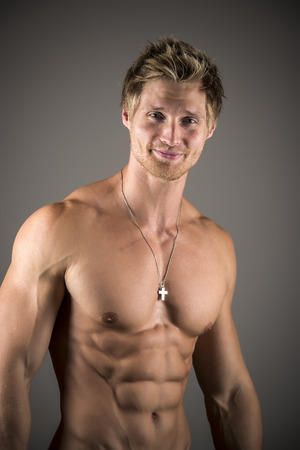 developed: Blond athletic man with well developed abs and pecs Stock Photo