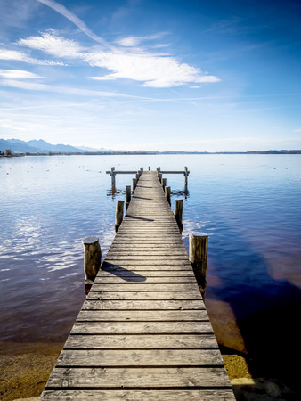 Jetty at the Chiemsee in Germany with blue sky photo