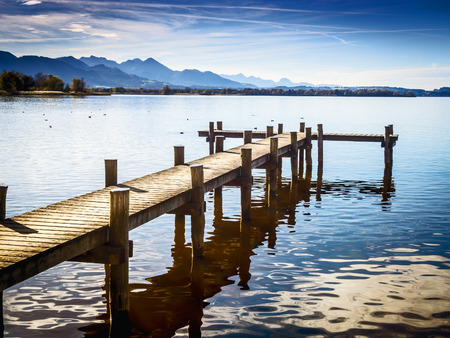 Jetty at the Chiemsee in Germany with blue sky