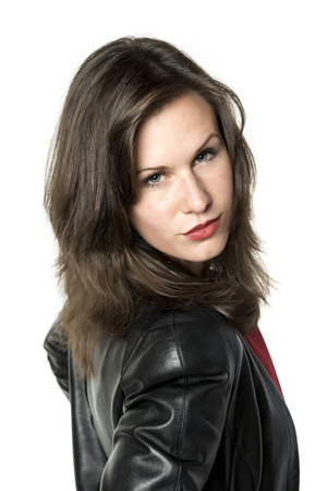 Portrait of a beautiful brunette woman with leather jacket, isolated on white background photo