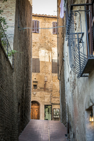 Image of a deserted alley in San Gimignano, Tuscany photo