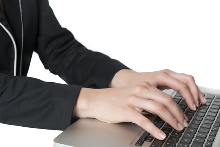 Image of female hands typing on keyboard of a notebook photo