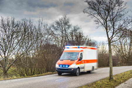 emergency light: Image of fast driving ambulance car Stock Photo