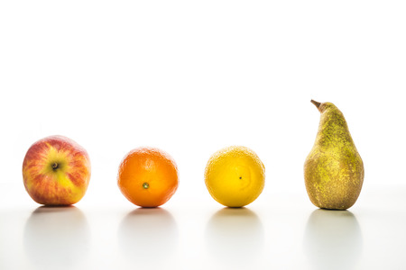 Image of fruits with an apple, mandarin, lime and pear on white  photo