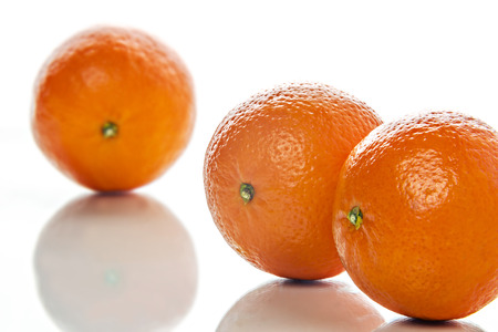 Image of three orange mandarins on white  photo