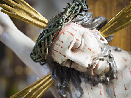 Figure of Jesus Christus with bloody face photo