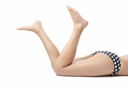 Image of female legs with bikini isolated on white background photo