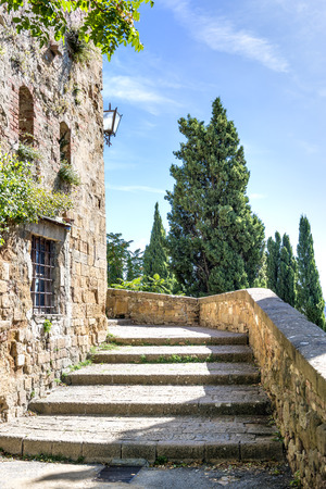 Stairs in Pienza, Italy, on a sunny day photo