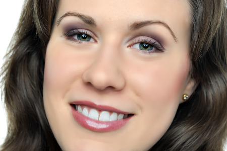 Face of a brunette smiling woman photo