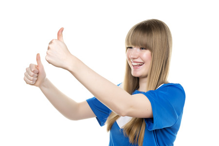 Happy girl in blue soccer shirt is holding her thumbs up photo