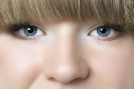 Closeup of face of blond woman with blue eyes photo