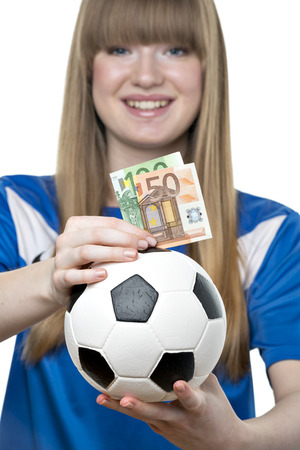 Young blond girl with bills and money box, isolated on white background photo