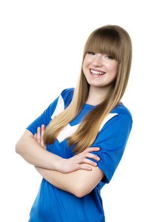 Girl in blue football shirt isolated on white background photo