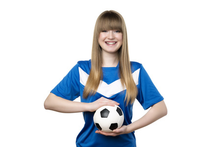 Girl in blue shirt is holding football isolated on white background photo