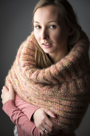 Portrait of a young woman with wool scarf photo
