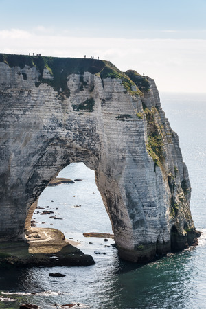 Alabaster coast of Normandy with rocks, sea and blue sky in France photo