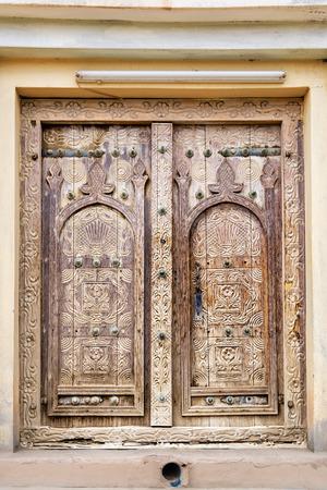 art door: Ancient door with carving in oasis Al Haway in Oman Stock Photo
