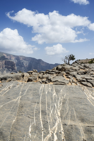 fractures: Image of rock walls on mountain Jebel Shams in Oman Stock Photo