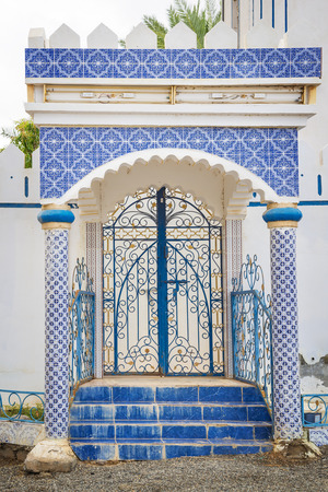 Building with blue mosaic tiles in Oman photo