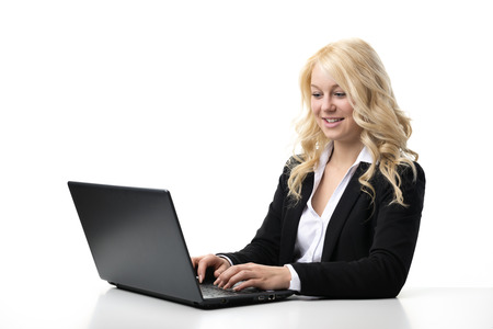 Blond business woman working on laptop photo