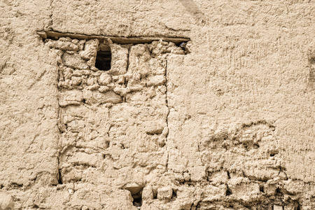 Image of a part of a clay wall in Birkat al mud in Oman Stock Photo