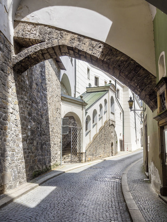 Narrow street Passau, Germany, a street with cobblestones in Summer  Stock Photo