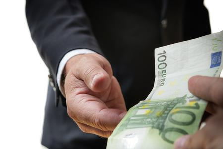 Businessman in dark suit receives a bill photo