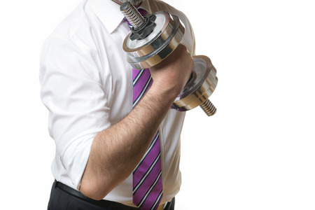 Businessman holding a silver dumbbell in the right hand