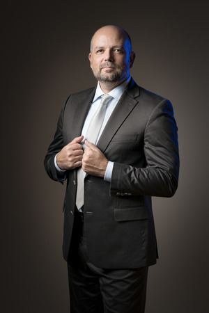 image of a serious business man with dark background