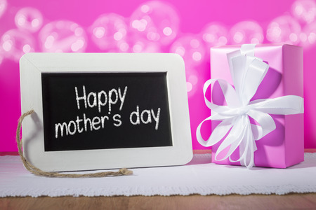 mother 's day: Image of a slate blackboard with chalk message Happy mother s day and pink poison Stock Photo