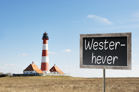 westerhever: Image of lighthouse westerhever in northern Germany and chalkboard with text Westerhever