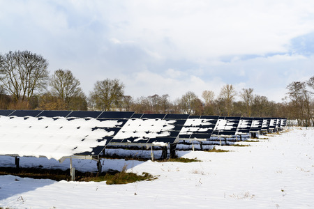 Solar Panel field in Bavaria Germany with snow on panels Stock Photo