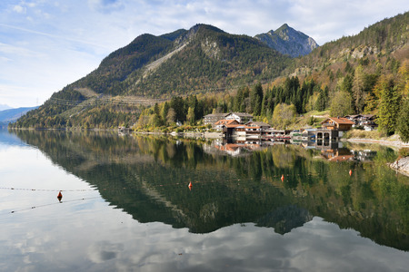 Image of the waterfront from the Walchensee with houses and Alps in Bavaria, Germany photo