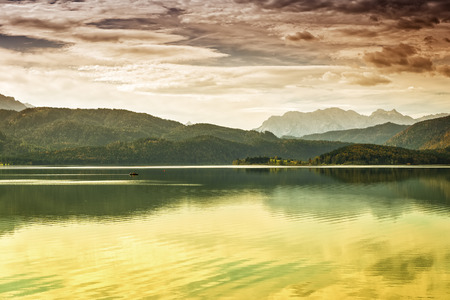 Image of the waterfront from the Walchensee with dramatic clouds and Alps in Bavaria, Germany photo