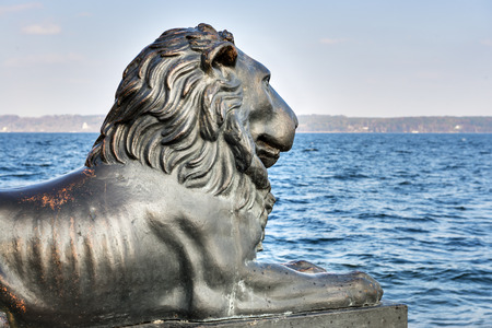 starnberger see: Lion statue at lake Starnberger See in Tutzing, Bavaria, Germany Stock Photo