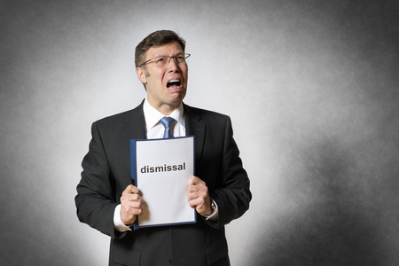 dismissal: Crying business man with german dismissal Stock Photo