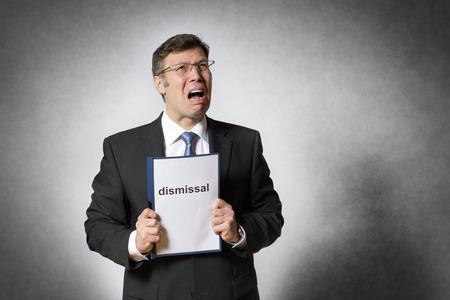 despido: Crying hombre de negocios con alem�n despido