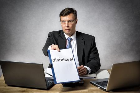 dismiss: Boss sitting at the desk in office dismiss somebody