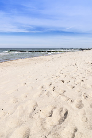 Picture of footprints in the sand on the empty beach of the Baltic Sea photo