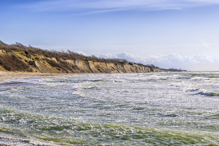 Coast at Ahrenshoop on the Baltic Sea in strong winds in the evening, Germany photo