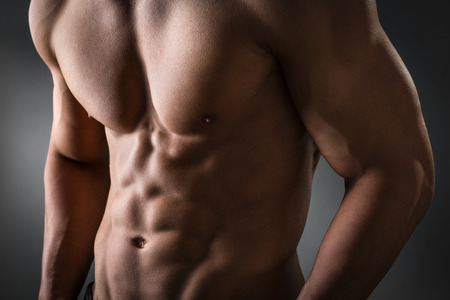 trained: Young man with well trained abdominal and pectoral muscle