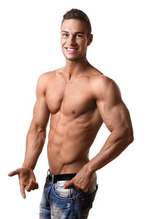 pecs: Forefront young man with well trained body, abs and pecs and wearing a denim trousers Stock Photo