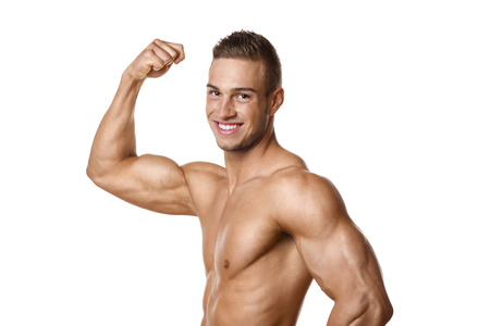 Young man with well trained body, biceps, abs and pecs Stock Photo