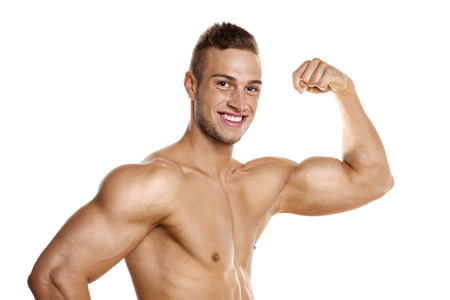pecs: Young man with well trained body, biceps, abs and pecs Stock Photo