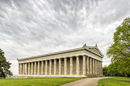 hill of the king: Image of the Walhalla in Bavaria, Germany with green meadow and dark clouds