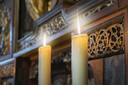 easter candle is burning: Image of two burning candles in an church Stock Photo