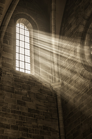 Image of a window in a church with sunbeams