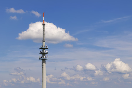 Image of broadcasting tower with blue sky and white clouds Stock Photo